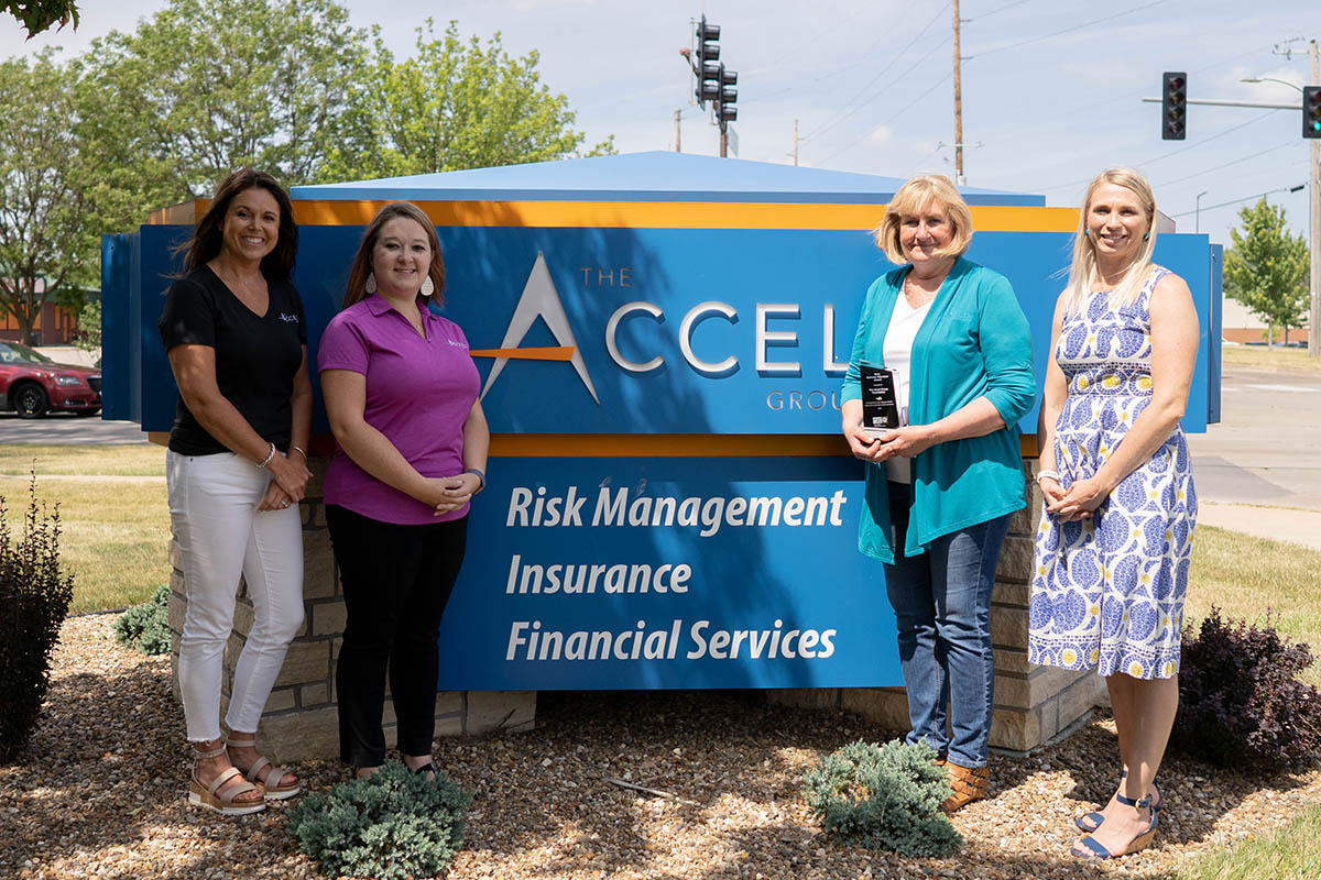 Accel Foundation - Team In Front Of Accel Group Sign